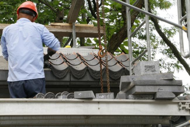 Renovations on the Chinese Garden – Summer 2017 -  Restoration of the Entrance Courtyard – setting tiles on the wall surrounding the courtyard